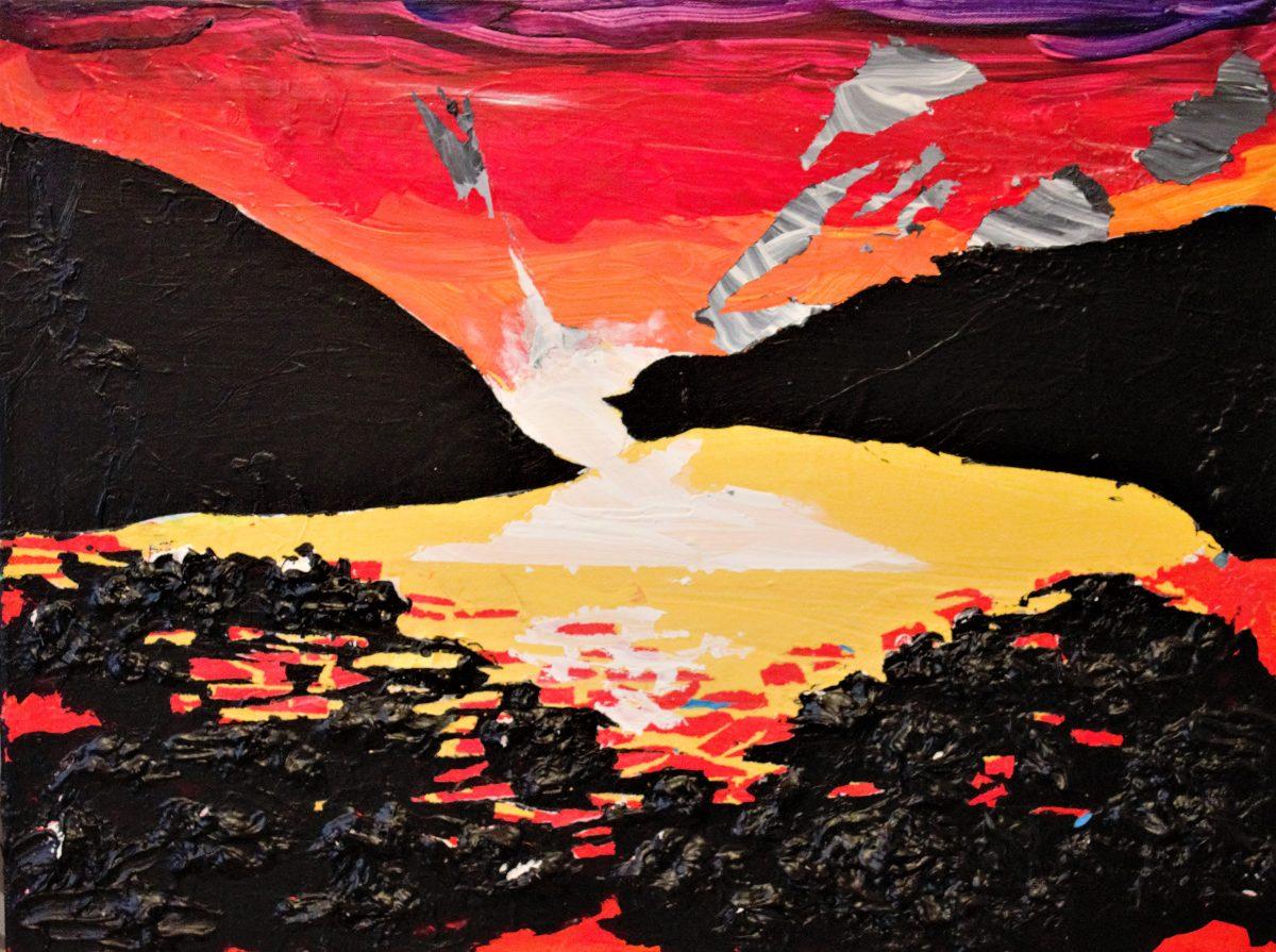 vibrant sunset in dramatic reds, yellows, and oranges over water with black rocks. Sun is setting between two large hills in black.