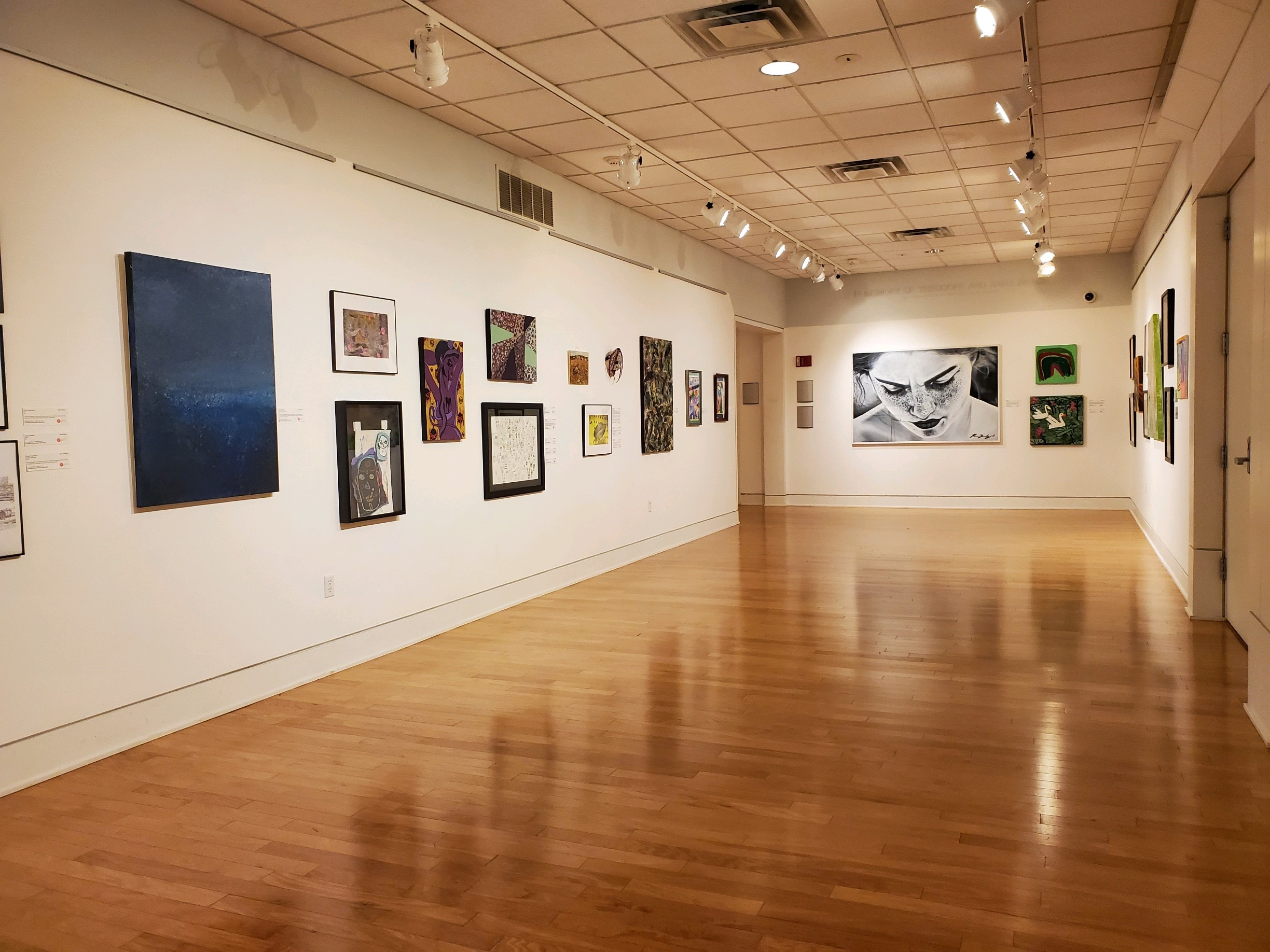full gallery view of the 2021 accessible expressions ohio exhibition gallery has white walls and high gloss hardwood floors