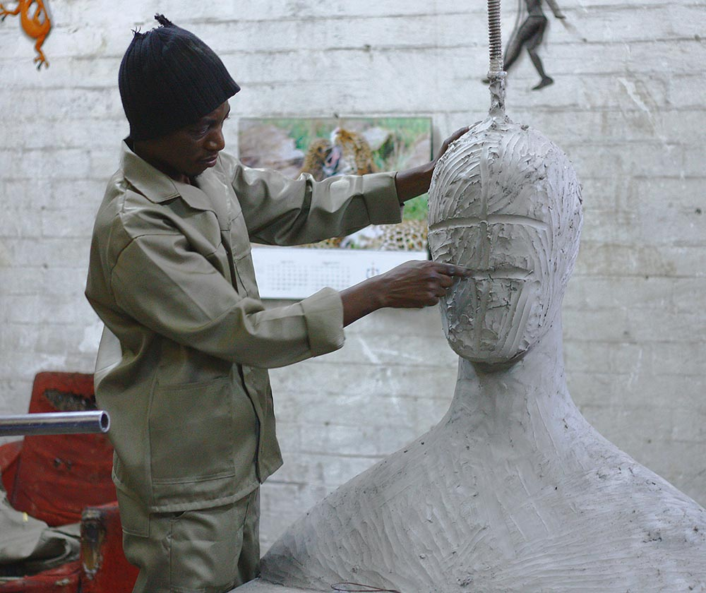 Image of a sculptor working on a large bust