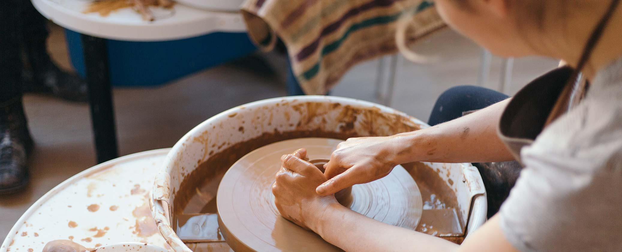 Photo of a person at a pottery wheel