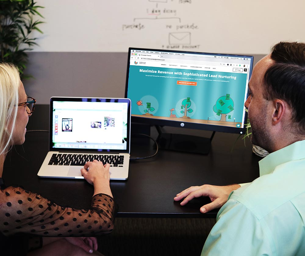 image of two people working together on a computer