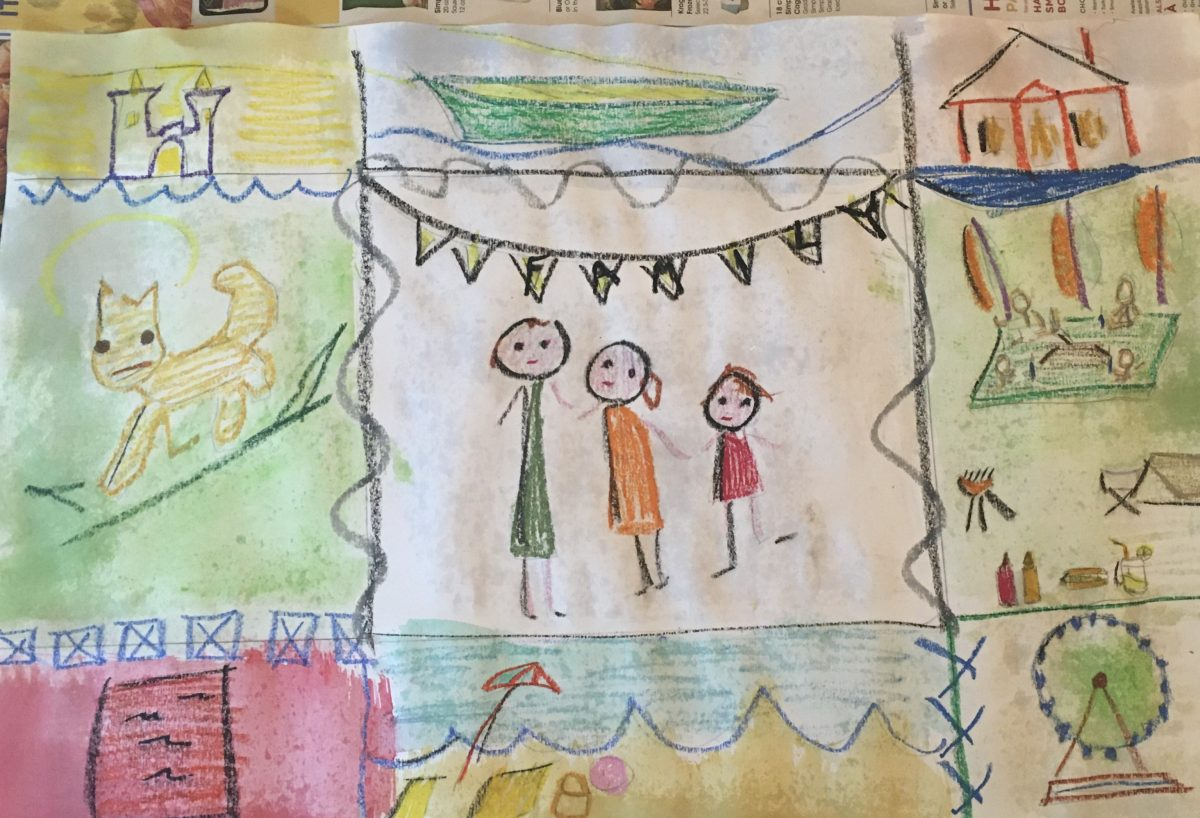 family quilt with hand drawn squares that include family, pets, and vacation destinations like camping, the beach, and an amusement park